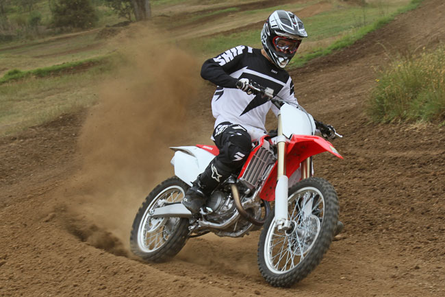 The 2014 CRF450R has increased power, but remains smooth as silk upon application. Image: Alex Gobert.